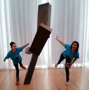 "Kelsey Hunt, left, and Harley Graham, right, students from Fairmont High School in Fairmont, North Carolina, pose with Joel Shapiro's 'Untitled' as part of a virtual exhibit they created during a ""flipped field trip"" at the North Carolina Museum of Art. Photo: Ashley Berdeau"