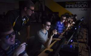 Keith Hodan | Trib Total MediaInside the Montour Virtual Immersion Lab at Montour High School, physics teacher Doug Macek watches over Anthony Catanzarite, 16, a junior, as the class practices using the new 3-D technology, Thursday, Sept. 10, 2015. Montour is the only school in Pennsylvania that has this new technology. Using special glasses, stylus, and monitor, the tech allows students to work on lessons that include the virtual dissection of everything from a red blood cell to a Tyrannosaurus Rex.