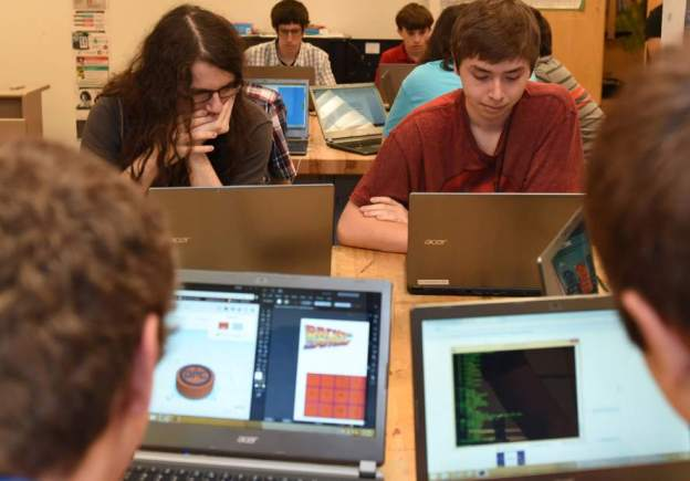 Keith Hodan | Trib Total MediaStudents in Reuben Clark's Introduction and Evolution of Games class, including Landin O'Neil, 17, a senior, left, and Tyler Vescio, 17, use their laptops to design games during the class at North Hills Senior High, Tuesday, Sept. 22, 2015.