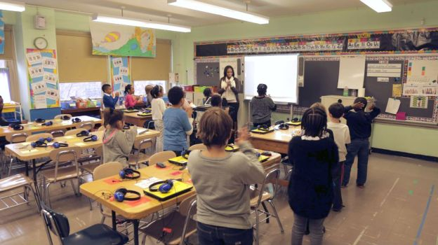 Sabrina Knight's second-grade students at a Brooklyn public school receive lessons in coding. Some school districts in the United States are attempting to expand computer science education while the Obama administration is pushing to bring the subject to every public school in the nation. Michael D. Regan/PBS NewsHour