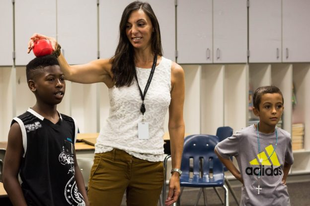 Speech-language therapist Dacia DeAngelis demonstrates gravity in a lesson with fourth grade students at Thurgood Marshall Elementary School in the Asbury Park School District in New Jersey. Photo: Jamie Martines