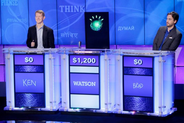 """The IBM computer platform Watson in 2011 with """"Jeopardy"""" champions Ken Jennings and Brad Rutter. Credit Seth Wenig/Associated Press"""