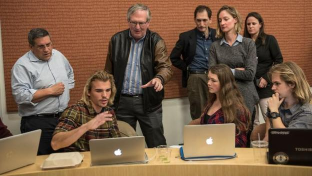 Steven Weinstein, center, an instructor of a class called Hacking 4 Diplomacy at Stanford University, helps students from a variety of fields come up with strategies to solve real-world problems. (David Butow / For The Times)